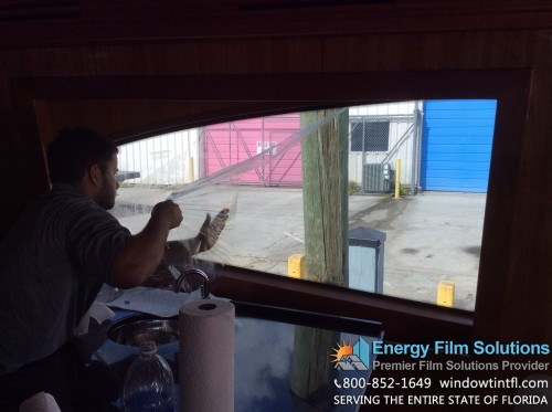 V-Kool Window Tinting being removed from this 77' Hatteras Yacht in Fort Lauderdale